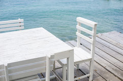 Wood dock White chair and table Stock Photos