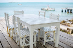 Wood dock White chair and table Royalty Free Stock Photography