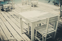 Wood dock White chair and table vintage Stock Photos