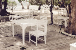 Wood dock White chair and table vintage Stock Image