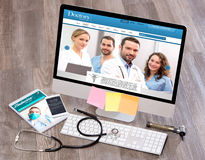 Wood doctor's desk in high definition with laptop, tablet and mo Stock Photos