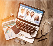 Wood doctor's desk in high definition with laptop, tablet and mo Royalty Free Stock Image