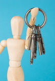 Wood doll holding set of retro keys Stock Photos
