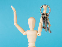 Wood doll holding set of retro keys Royalty Free Stock Photography