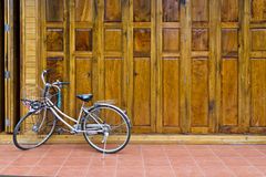 Wood Door. Old wood brown and bicycle on closed door Royalty Free Stock Image