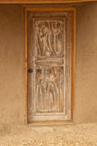 Wood door in an adobe wall Royalty Free Stock Photography