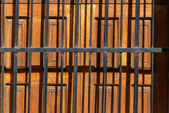 Wood door  with black grating ind etail Stock Photography
