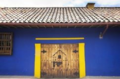 Wood door in Bogotá. Front view of a colonial house at the historical district know as La Candelaria in Bogota,Colombia Stock Photo