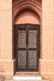 Wood door, and brick wall Stock Photo