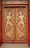 Wood door carves in a temple Stock Image