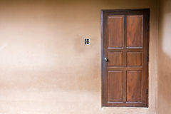 Wood door closed on wall. Royalty Free Stock Images