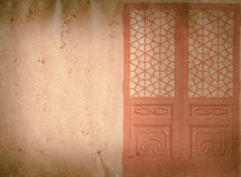 Wood door on grunge paper texture Royalty Free Stock Photo