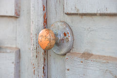 Wood Door handle on obsolete wooden background Stock Photography