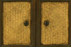 Wood Door handles. And bamboo stick cross Royalty Free Stock Photos