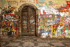 Wood Door In The Lennon Wall Royalty Free Stock Image