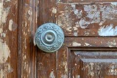 Wood door metal handle Stock Image