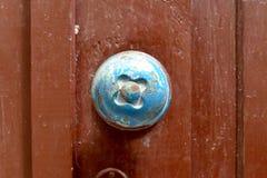 Wood door metal handle Stock Images