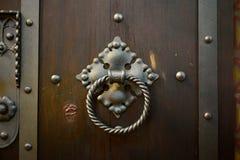 Wood door metal handle Royalty Free Stock Photos