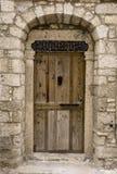 Wood Door. Old Wood Door on Stone Wall Stock Images