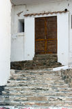 Wood door and stone stairs in Cadaques Spain Royalty Free Stock Photos