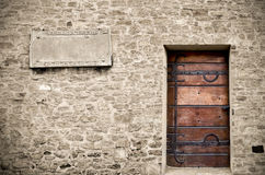 Wood door on stone wall Stock Image