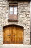 Wood door stone wall Besalu Catalunya Spain Stock Image