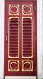 Wood door of temple Stock Images