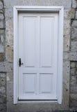 Wood Door. White Door on Stone Wall Stock Image
