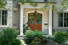 Wood Doors. Beautiful home entrance / front doors made of wood royalty free stock photography