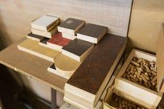 Wood dowel pins and board samples at workshop Royalty Free Stock Photos