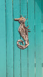 Wood driftwood seahorse decor on an aqua blue Royalty Free Stock Photos