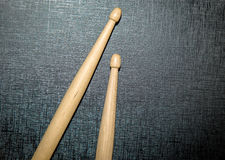 Wood Drumsticks in black texture background Royalty Free Stock Photos