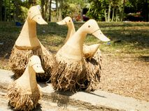 Wood ducks Family. Four wooden ducks made by root of bamboo royalty free stock photo