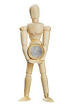 Wood dummy with euro Royalty Free Stock Photo