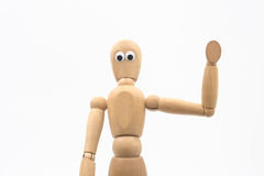 Wood dummy with googly eyes says hello - white background. Still life Royalty Free Stock Photo