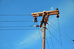 Wood electricity poles Royalty Free Stock Photo
