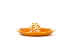 Wood element aromatic mixture of twigs on the orange plates Stock Photo