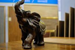 Wood elephant on table Stock Photo