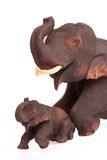 Wood elephents on white blackground Stock Photos