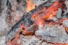 Wood embers detail in fire place Stock Images