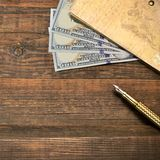Wood Empty Background With Notebook, Money  And Golden Pen Royalty Free Stock Photos