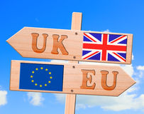 Wood exit arrow sign, clipping path. Road sign with the flags of the European Union and the United Kingdom, depicting the Brexit concept. Illustration Royalty Free Stock Image