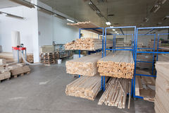 Wood factory. Wooden planks stacked in order inside of factory royalty free stock photos