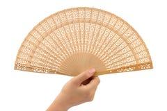 Wood fan in woman hand Stock Photo