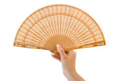 Wood fan in woman hand Royalty Free Stock Images