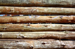 Wood fence. Rustic brown log fence outdoor Stock Photo