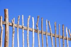 Wood fence. On blue background Stock Photo