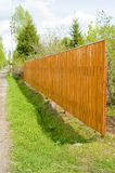 Wood fence. New orange wooden country suburban fence, Russia Royalty Free Stock Photos