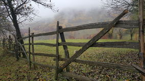 Wood fence. Autumn day in mountain. Nature Stock Photos