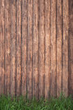 Wood fence background with green grass Royalty Free Stock Image